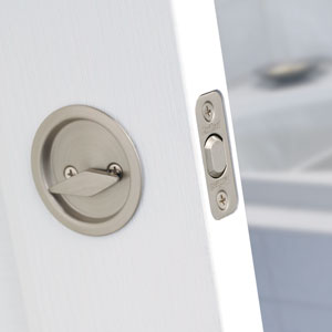 Round pocket door lock passage in satin nickel