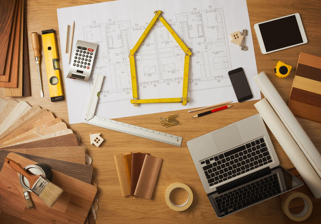 Array of interior design and architecture tools on a wooden table