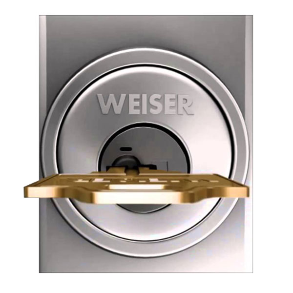 Gold key sitting horizontally in a Weiser deadbolt