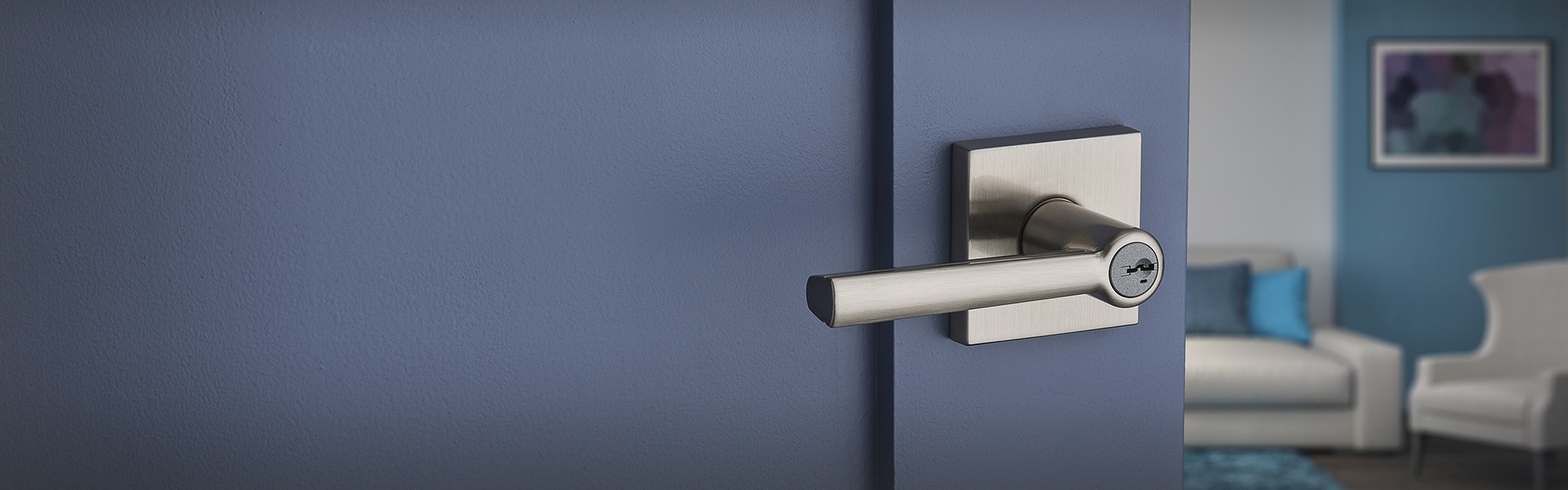 Contemporary lever on blue living room door.